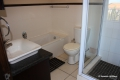Main en-suite bathroom at Kubu Bali self catering apartment accommodation in Shelly Beach