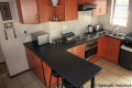 Kitchen at 11 Stafford Place self catering accommodation in Uvongo on the KZN South Coast