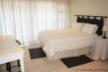 Main bedroom at 5 Kuta Beach self catering accommodation in Ramsgate on the KZN South Coast
