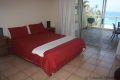 Main bedroom at Strandloper self catering accommodation in Uvongo on the KZN South Coast.